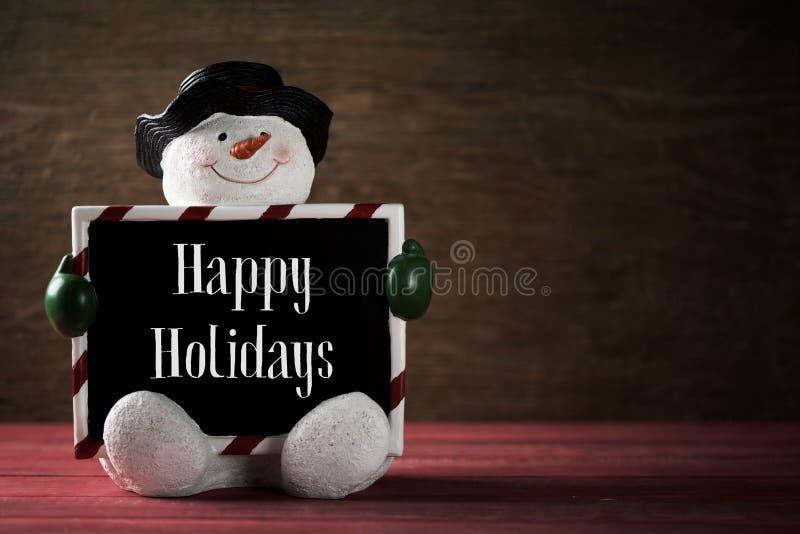 Bonhomme de neige et texte bonnes fêtes photos stock