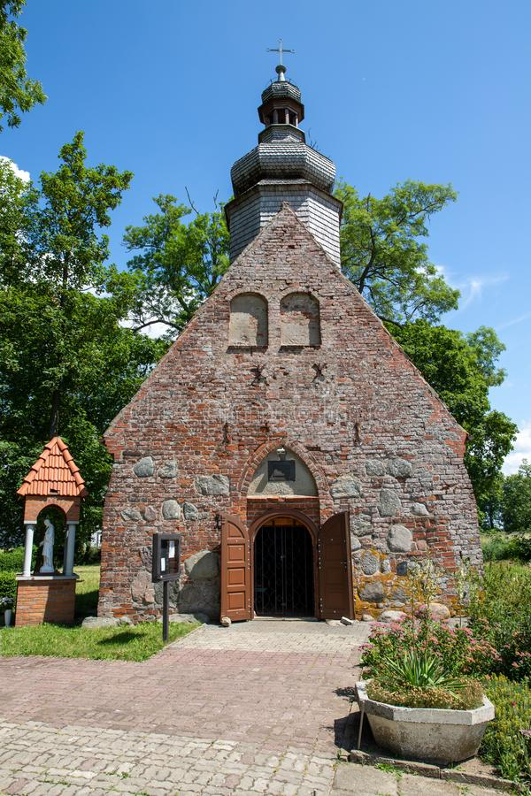 Free Bonin, Zachodniopomorskie / Polska - June 28, 2019: A Small Red Brick Church. Temple With A Wooden Tower In Central Europe Stock Image - 151823761