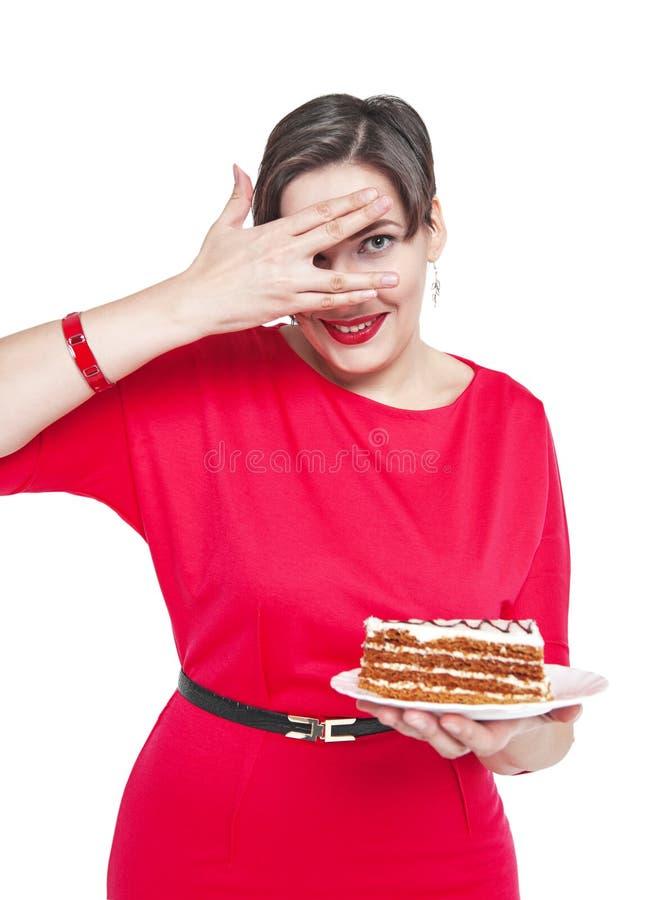 Bonito mais a mulher do tamanho com o bolo isolado foto de stock
