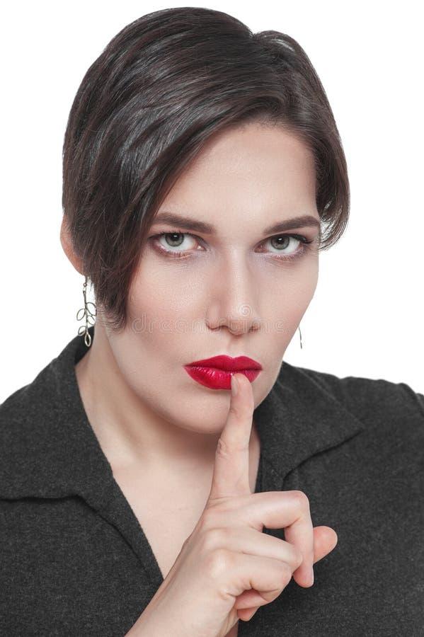 Bonito mais a mulher do tamanho com o dedo nos bordos isolados imagens de stock royalty free