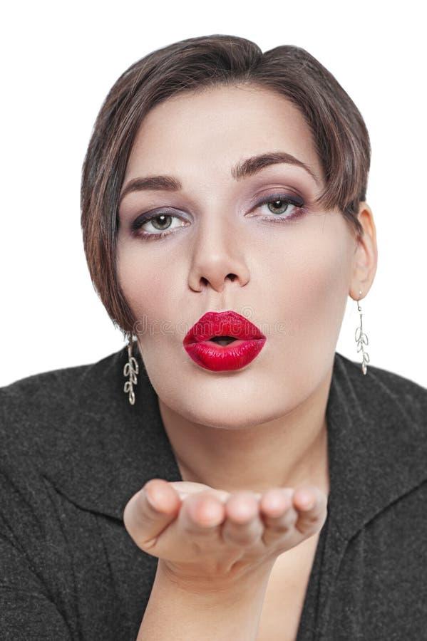 Bonito mais a mulher do tamanho que envia o beijo isolado imagem de stock royalty free