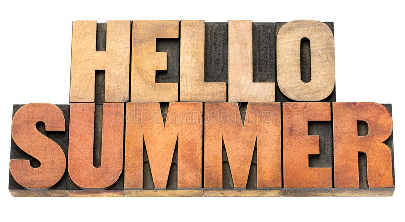 Bonjour été - exprimez le résumé dans le type en bois photo stock