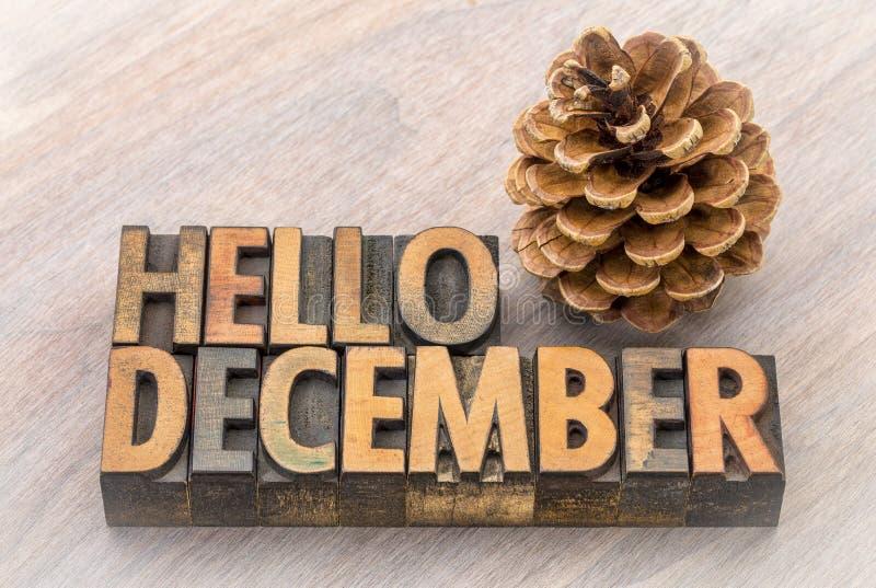 Bonjour abrégé sur mot de décembre dans le type en bois images libres de droits