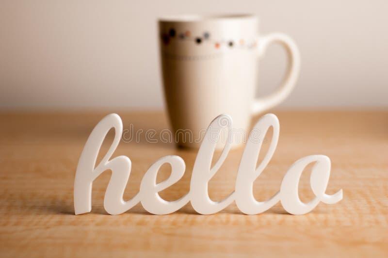 bonjour devant la tasse de caf image stock image du lettres salutation 24653155. Black Bedroom Furniture Sets. Home Design Ideas
