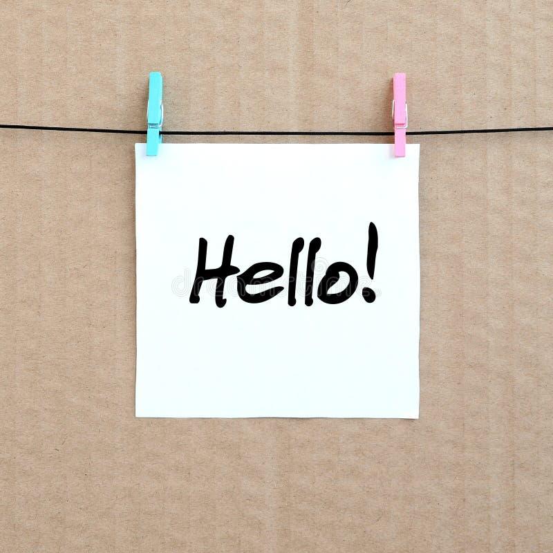 Bonjour ! La note est écrite sur un autocollant blanc qui accroche avec un caillot image stock