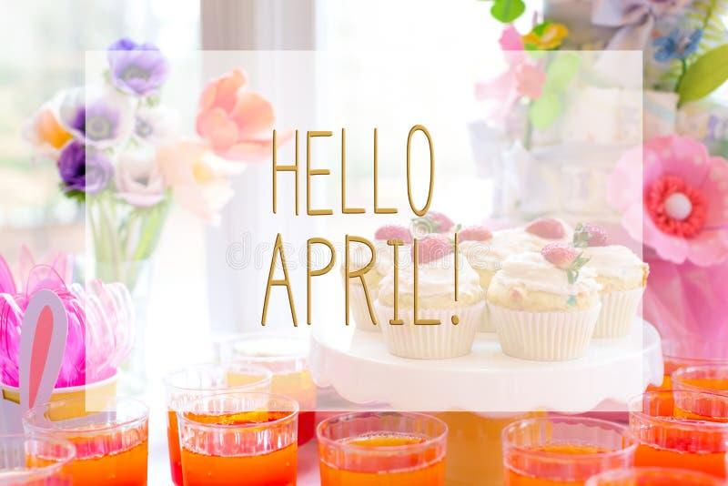 Bonjour message d'avril avec la table de dessert image libre de droits