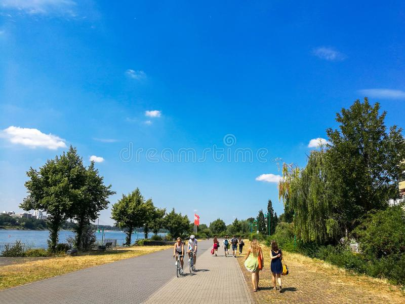 BONN - July 13: people in the park in Bonn, Germany walking along the Rhine river royalty free stock photography