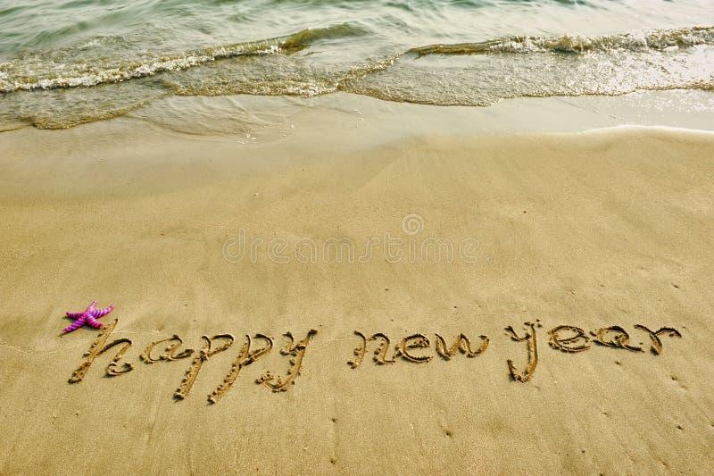 Bonne année écrite en plage images libres de droits