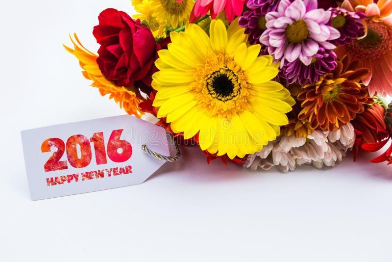 Bonne année 2016 avec la fleur et étiquette d'isolement sur un fond blanc photographie stock