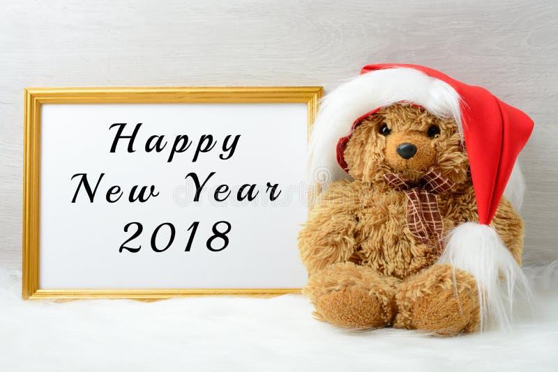 Bonne année 2018 avec un ours de nounours mignon photo stock