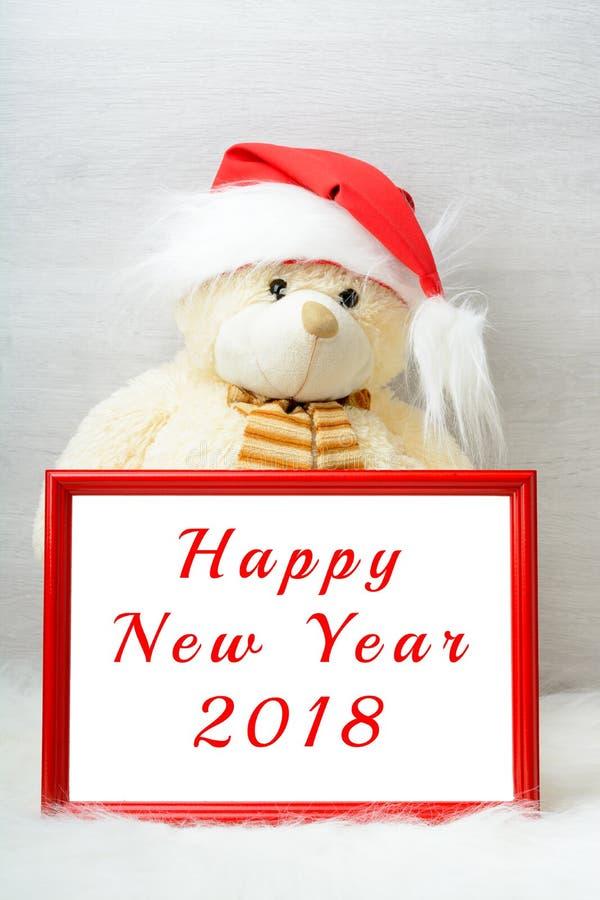 Bonne année 2018 avec un ours de nounours mignon photos stock