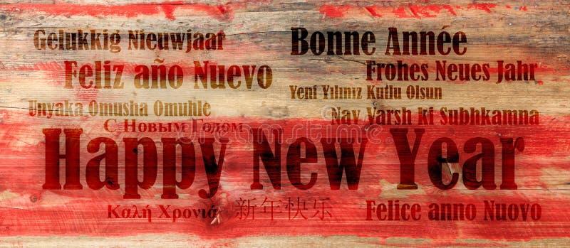 Bonne année dans beaucoup de langues sur le fond en bois rouge images libres de droits