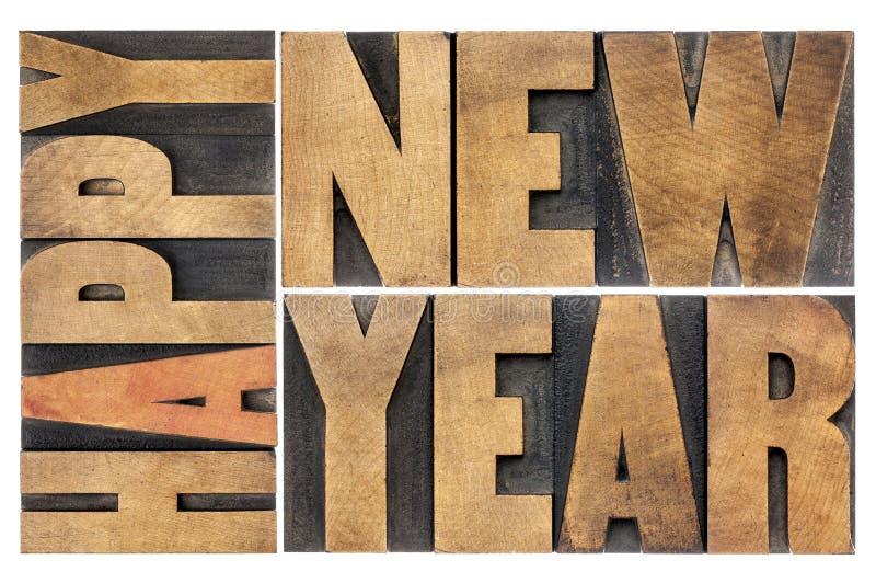Bonne année dans le type en bois images stock