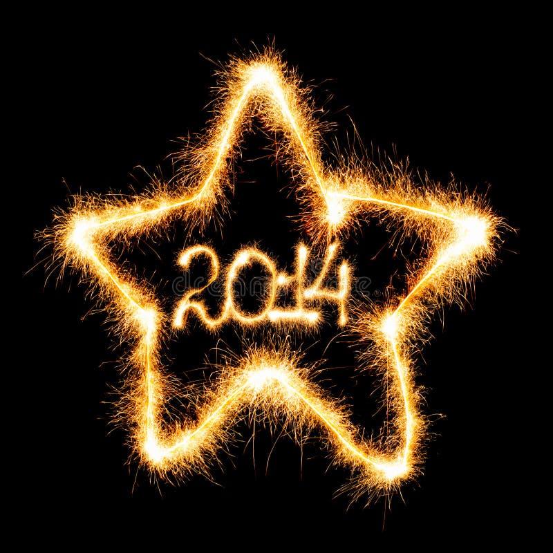 Bonne année - 2014 en étoile a fait un cierge magique photographie stock