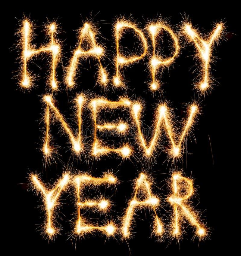 Bonne année faite d'étincelles sur le noir images stock