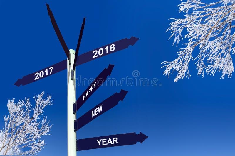 Bonne année 2018 sur des panneaux de direction, arbres neigeux photos stock