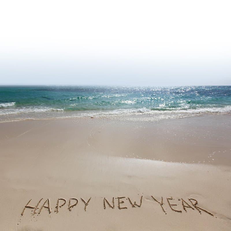 Bonne année sur la plage photographie stock
