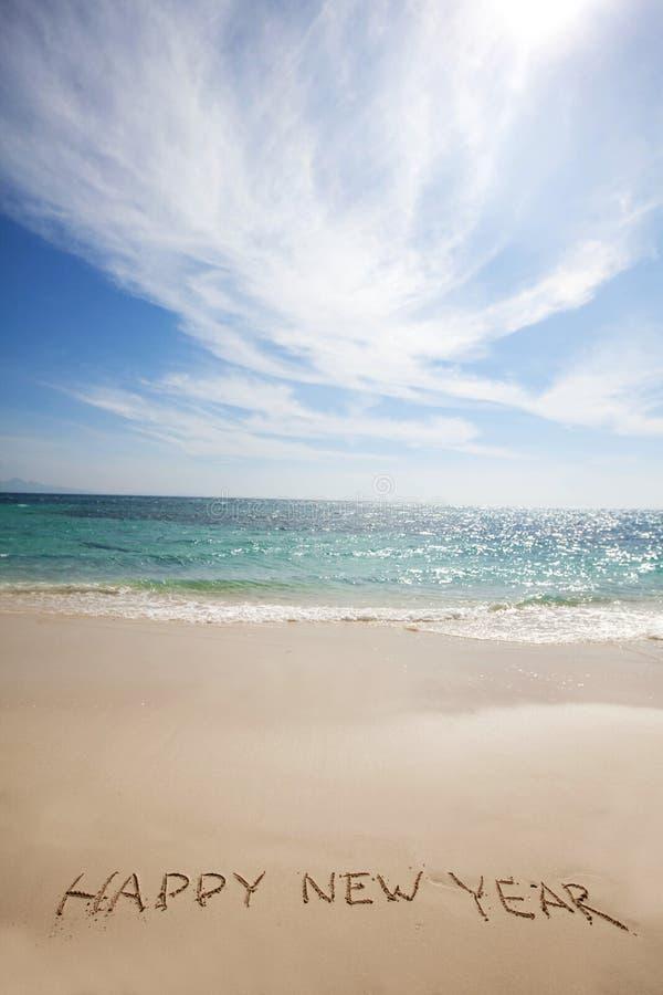 Bonne année sur la plage photographie stock libre de droits