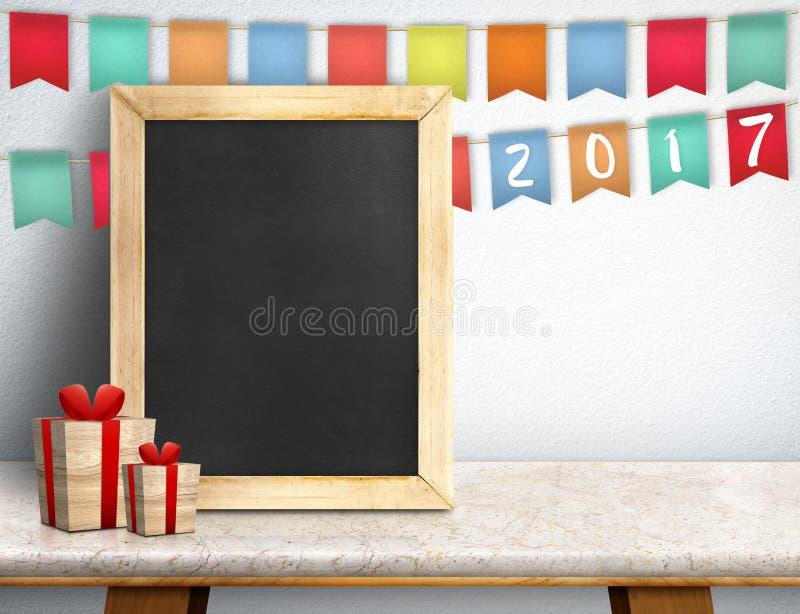 Bonne année sur le tableau noir avec le cadeau et la bannière colorée de drapeau photo libre de droits