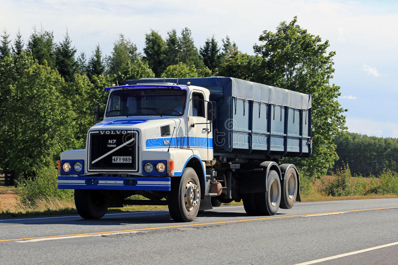Bonneted Volvo N7 Truck on Summer Road. SALO, FINLAND - AUGUST 30, 2015: Blue and white bonneted Volvo N7 truck moving along highway in South of Finland stock images