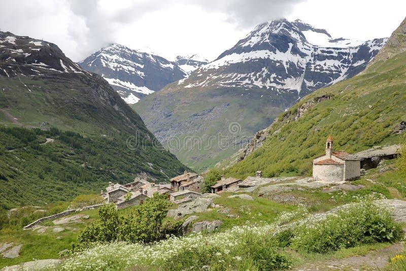 BONNEVAL-SUR-ARC, ΓΑΛΛΊΑ: Το χωριουδάκι Λ ` Ecot στο εθνικό πάρκο Vanoise, βόρειες Άλπεις στοκ φωτογραφίες