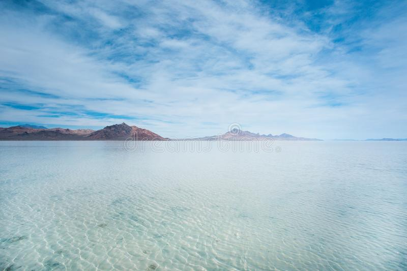 Bonneville Salt Flats, Tooele County, Utah, United States. Crystal clear water with mountains and blue, cloudy sky. Bonneville Salt Flats, Tooele County, Utah stock photos