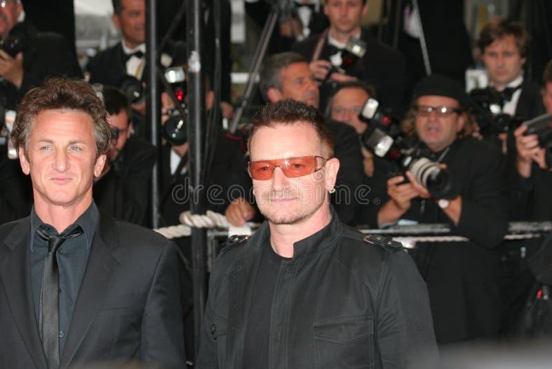Bono en Sean Penn stock afbeeldingen