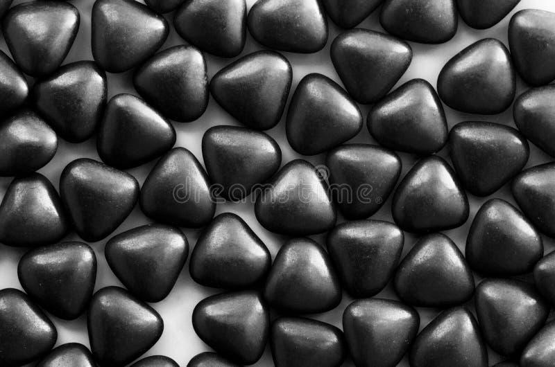 Bons för konfettigodisbon med formen av en hjärta arkivbilder