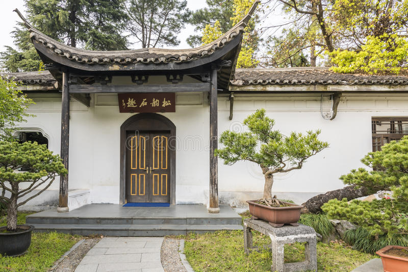 Bonsai and house in Duojing garden royalty free stock photos