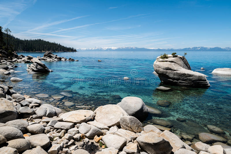 Bonsai Rock seen from shoreline of Lake Tahoe royalty free stock images
