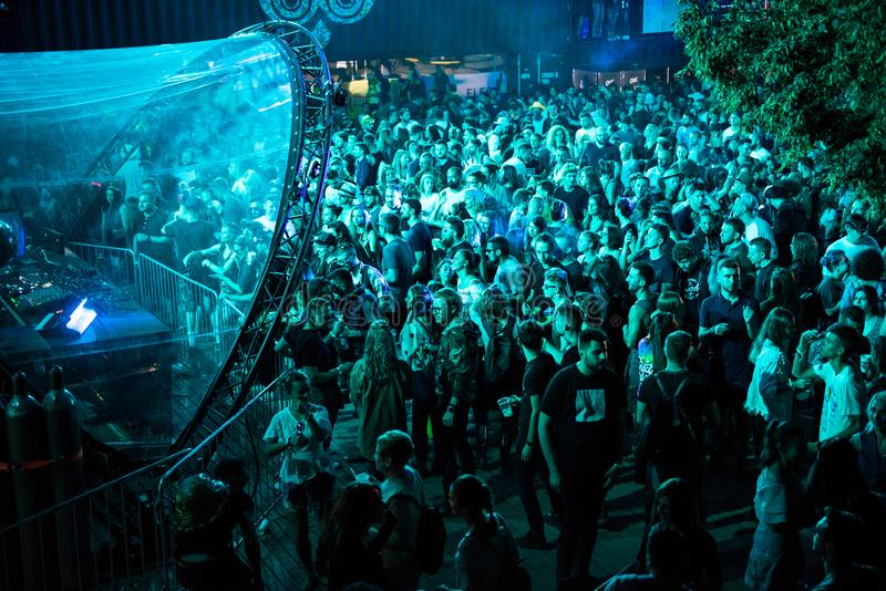 People clubbing and having fun. BONTIDA, ROMANIA - JULY 20, 2018: Crowd of people dancing and clubbing at Electric Castle festival during a Dj Heion concert stock photo