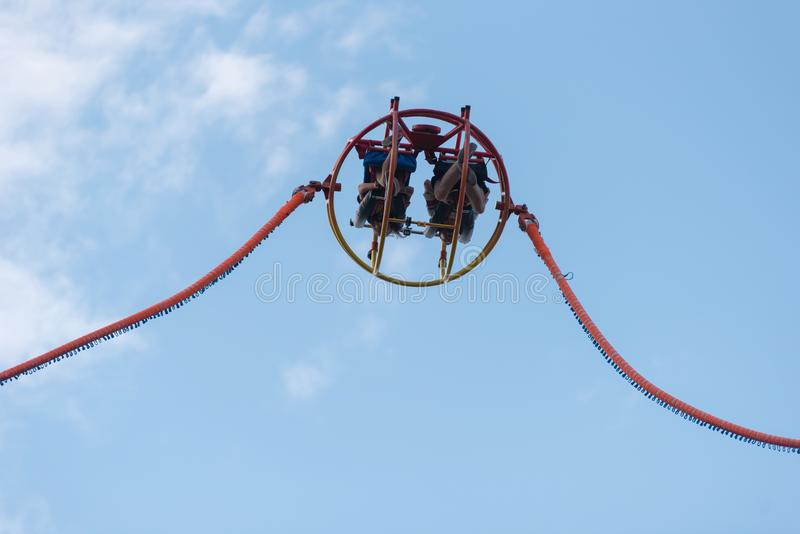 Reverse or catapult bungee. BONTIDA, ROMANIA - JULY 20, 2018: People enjoying reverse bungee at Electric Castle festival royalty free stock photography