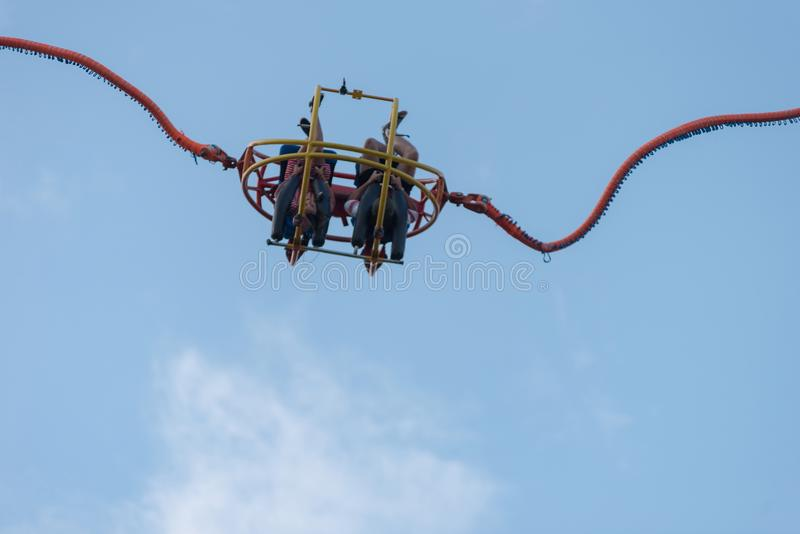 Reverse or catapult bungee. BONTIDA, ROMANIA - JULY 20, 2018: People enjoying reverse bungee at Electric Castle festival stock image