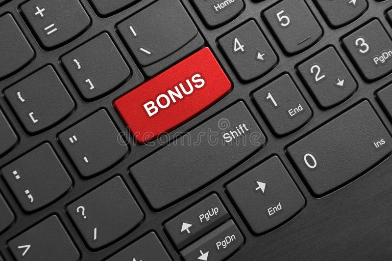 Bonus button keyboard. Bonus button placed on  a laptop black keyboard background - studio shot royalty free stock photography