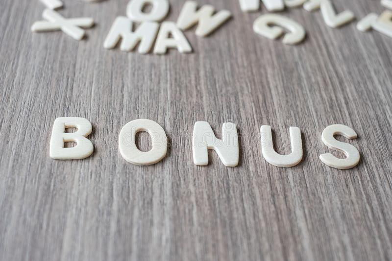 BONUS word of wooden alphabet letters. Business and Idea. Concept royalty free stock images