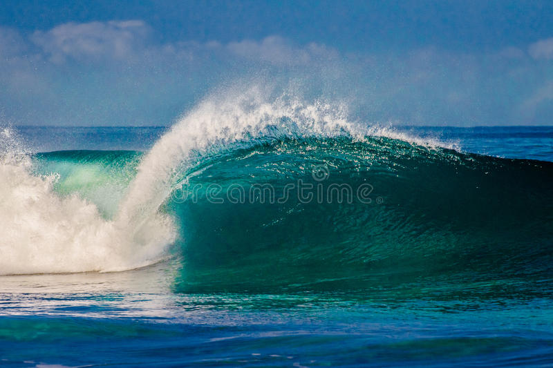 Bonzai Pipeline on Oahu's North Shore in Hawaii. Surfing waves on Oahu's North Shore in Hawaii stock photography