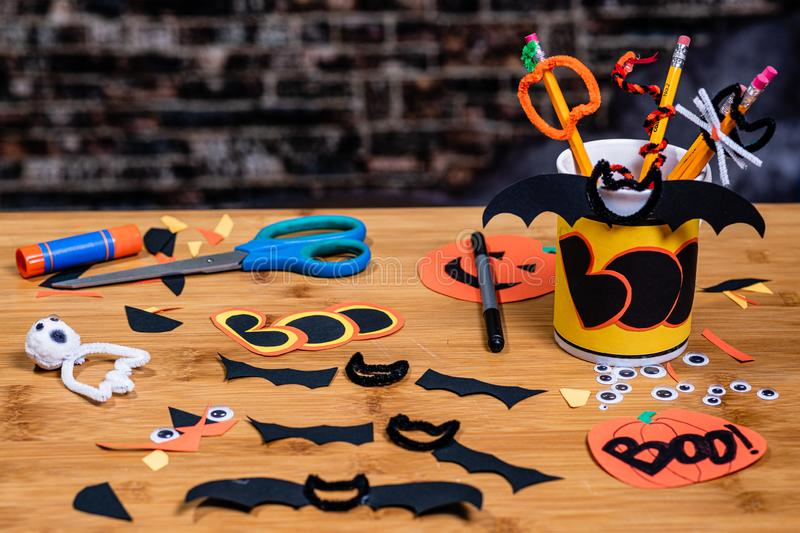 `Boo`, and other Halloween crafts from construction paper and pipe-cleaners. Many Halloween elements are visible royalty free stock image