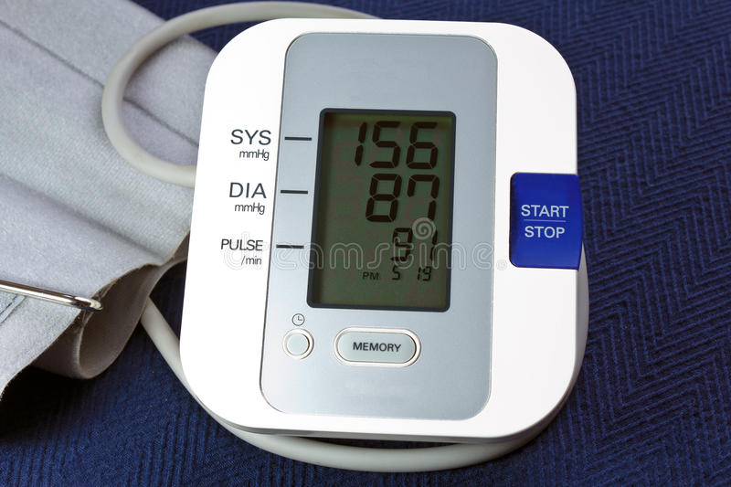 Bood Pressure Monitor. With cuff and showing hypertension stock photo