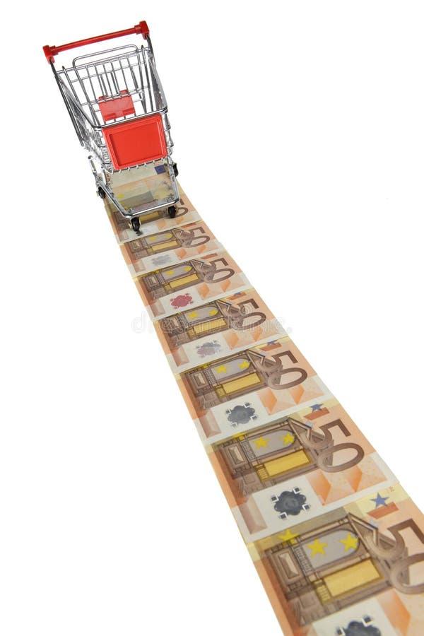 Boodschappenwagentje op Euro bankbiljetten stock afbeelding