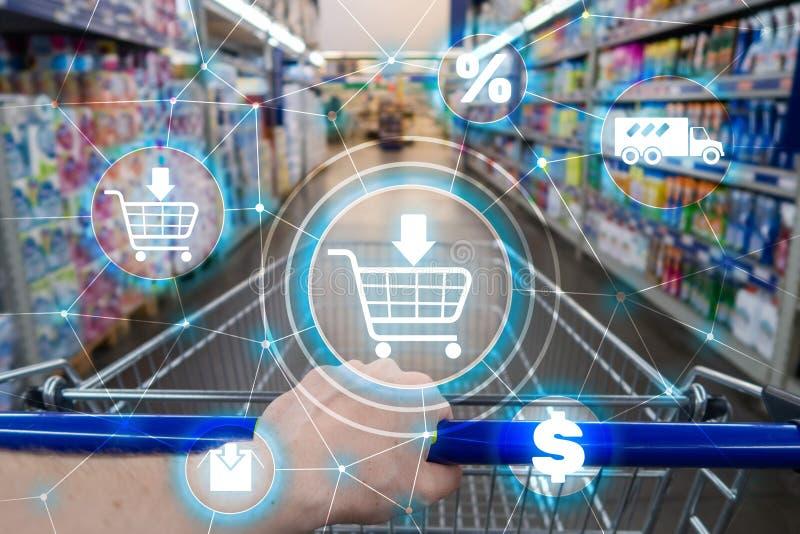 Boodschappenwagentjeelektronische handel Marketing het concept van de kanaaldistributie op supermarktachtergrond stock fotografie