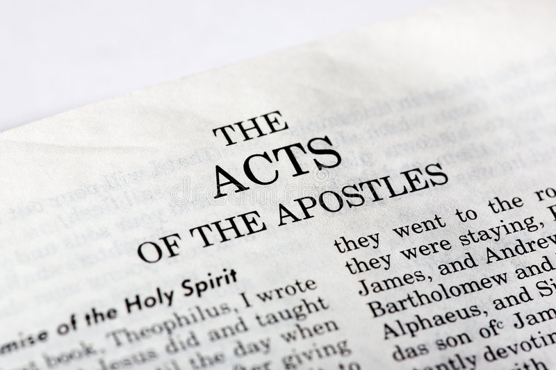 Book of Acts. A macro detail of the book of Acts in the Christian New Testament stock photography