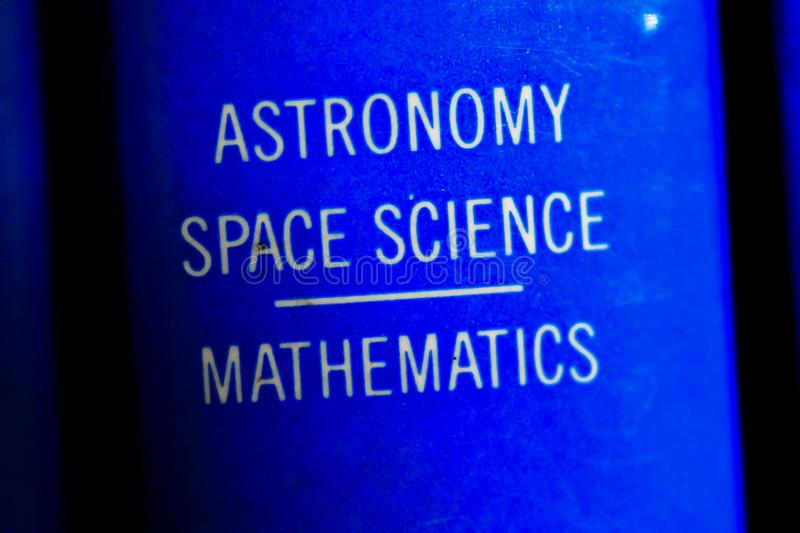 Book on astronomy. Macro image of a astronomy, space science, mathematics book in blue background stock images