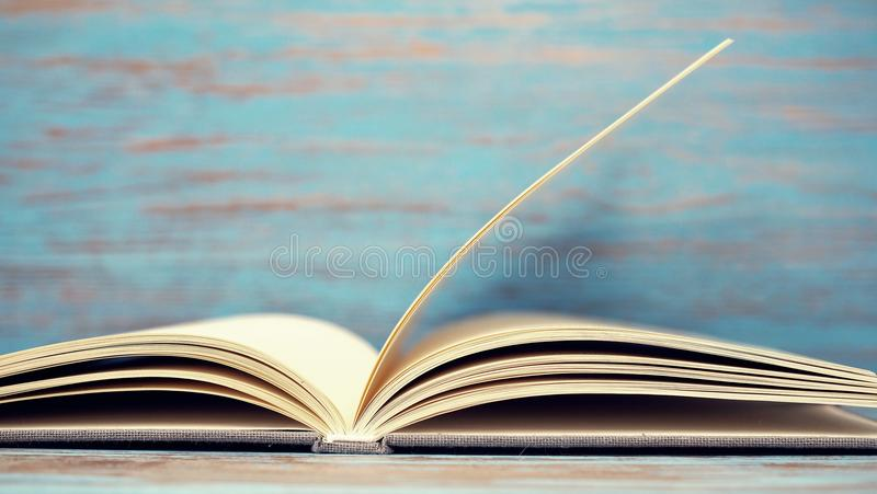Book on blue wood background. stock images