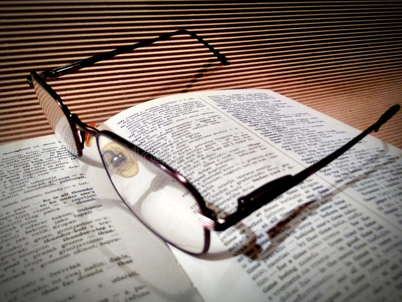 Book. Dictionary, glasses, reading, study, pause stock photo