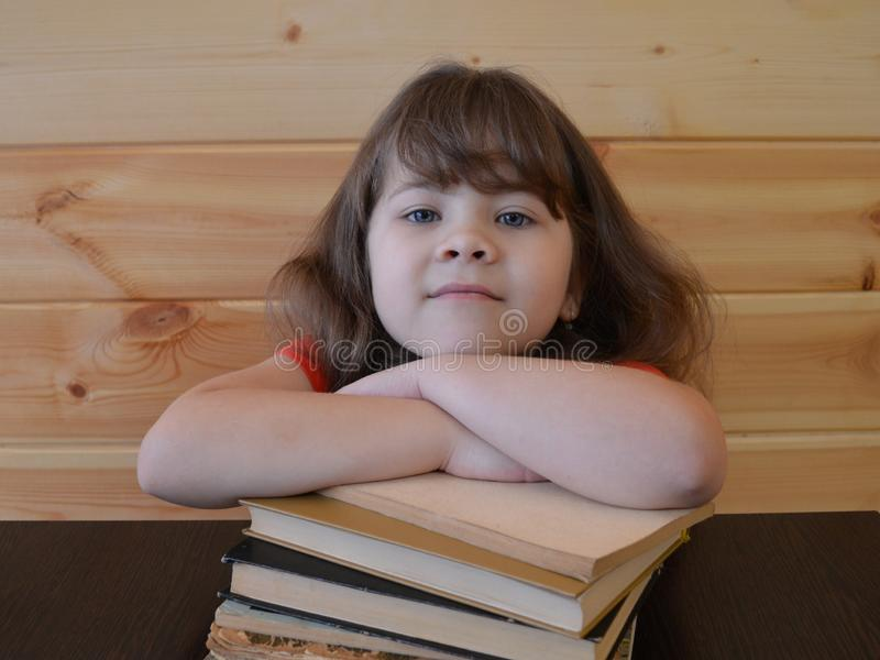Book, child, education, reading, student, young, woman, school, little, learning, white, read, studying, cute, books, beautiful, h royalty free stock images