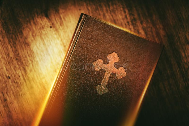 Book of Christianity. Vintage Book in Glowing Light Concept. Christian Education stock photography