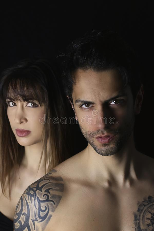 Book cover design. beautiful woman and an handsome man on black background royalty free stock photo