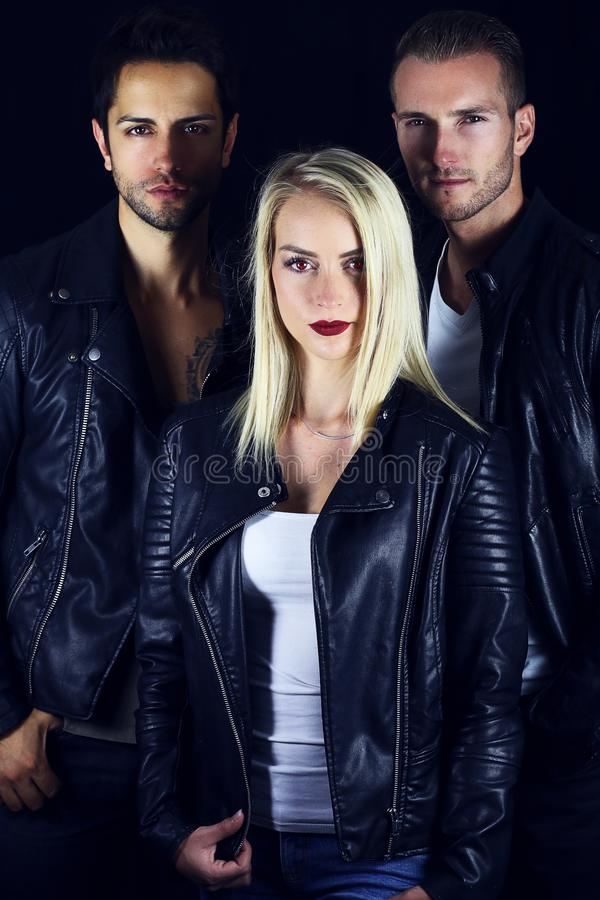 Book cover for vampire novel . three attractive vampires. On a black background royalty free stock photography