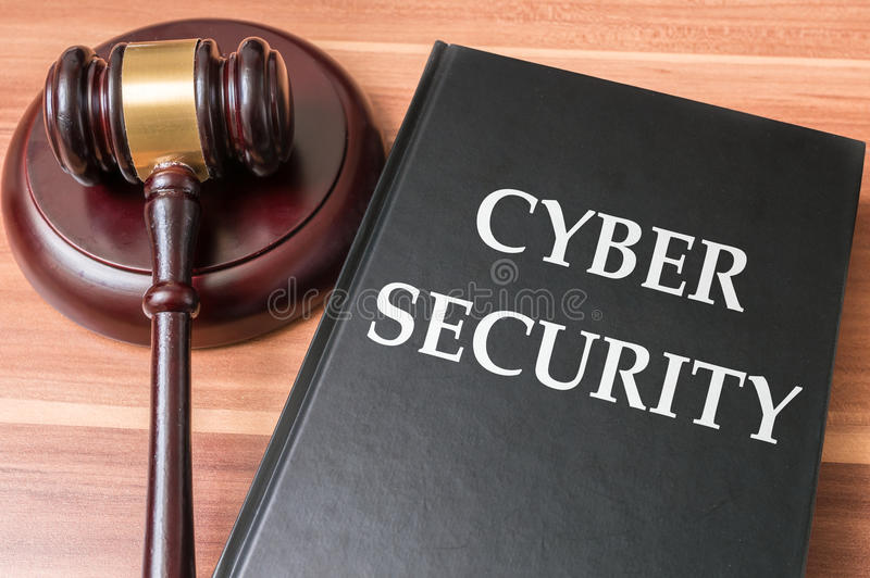 Book with cyber security laws. Justice and legislation concept stock photos