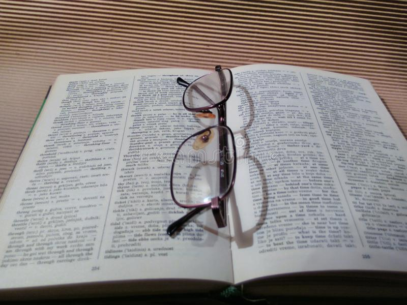Book. Dictionary, glasses, education, pause, work royalty free stock photo